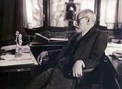 Freud Photo Framed Prints - Sigmund Freud Seated In His Study Framed Print by Everett