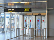 Tallinn Airport Photo Posters - Sign Leading to Baggage Claim Poster by Jaak Nilson