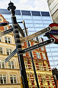 Metro Photo Metal Prints - Signpost in London Metal Print by Elena Elisseeva