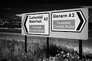 Antrim Photos - Signposts For The Causeway Coastal Route At Carnlough Between Cushendall And Glenarm County Antrim by Joe Fox