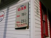 Signs On A Historic Gas Station Offer Print by Amy White & Al Petteway