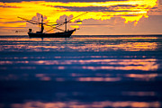 Huahin Prints - Silhouette boat at sea Print by Arthit Somsakul