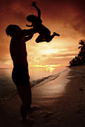 Sundown Posters - Silhouette Family Of Child Hold On Father Hand Poster by Anek Suwannaphoom