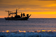 Huahin Posters - Silhouette fisherman on boat in sunset huahin Poster by Arthit Somsakul