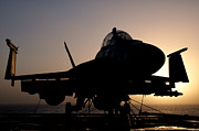 Chained Prints - Silhouette Of A Us Navy Fa-18e Super Print by Giovanni Colla