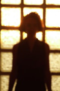 Sami Sarkis Metal Prints - Silhouette of a woman standing in front of a window Metal Print by Sami Sarkis
