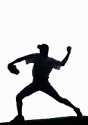 Baseball Cap Posters - Silhouette Of Baseball Pitcher About To Pitch Poster by PM Images