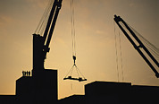Cranes And Derricks Etc. Art - Silhouette Of Cranes And Workers by Joel Sartore