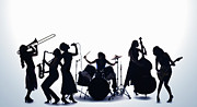 Drum Kit Prints - Silhouette Of Female Musicians Print by PM Images