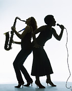 Saxophone Photos - Silhouette Of Female Singer And Saxophone Player by PM Images