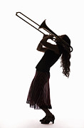 Arts Culture And Entertainment Framed Prints - Silhouette Of Female Trombone Player Framed Print by PM Images