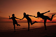 Women Together Posters - Silhouette Of Friends In Sunset Poster by Suwit Ritjaroon