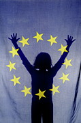 European Union Prints - Silhouette of girl with arms raised behind European Union Flag Print by Sami Sarkis