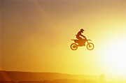 Mid-distance Prints - Silhouette Of Motocross Race In Mid Air, Sunset, Side View Print by John P Kelly