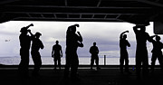 Hangar Prints - Silhouette Of Sailors In The Hangar Bay Print by Stocktrek Images