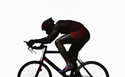 Triathlon Prints - Silhouette Of Triathlete Riding On Bicycle, Side View Print by Paul Taylor