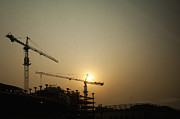 Tower Crane Posters - Silhouetted Construction Cranes Poster by Shannon Fagan