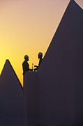 Silhouettes Metal Prints - Silhouetted Construction Workers Metal Print by Michael Melford