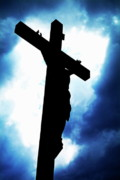 Crucifix Art Photo Posters - Silhouetted crucifix against a cloudy sky Poster by Sami Sarkis