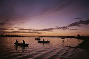 River Scenes Photos - Silhouetted Fishermen On The  Kissimmee by Medford Taylor