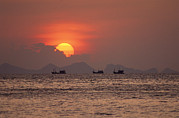 Silhouettes Metal Prints - Silhouetted Fishing Boats On The Water Metal Print by Michael Melford