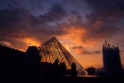 Art Museum Prints - Silhouetted glass pyramid and buildings of the Musee du Louvre inParis Print by Sami Sarkis