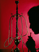 Bong Metal Prints - Silhouetted Man Smoking Cannabis From A Pipe Metal Print by Tek Image