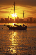 Scenes And Views Prints - Silhouetted Sailboat At Sunrise Print by Michael Melford