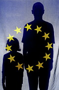 European Union Prints - Silhouettes behind European Union Flag Print by Sami Sarkis