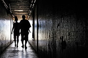 Bonding Metal Prints - Silhouettes of couple walking in a dark corridor Metal Print by Sami Sarkis