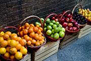 Tangerines Photos - Six Baskets Of Assorted Fresh Fruit by Todd Gipstein