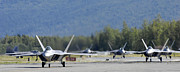 Taxiway Prints - Six F-22 Raptors Taxi Down The Runway Print by Stocktrek Images