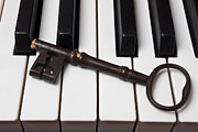 Play Prints - Skeleton key on piano keys Print by Garry Gay