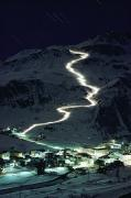 Night Scenes Photos - Skiers Bearing Torches Ski Down Mont by George F. Mobley