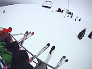 Ski Photos - Skiers Sitting On Chairlift by William Andrew