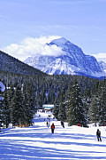 Lake Louise Photos - Skiing in mountains by Elena Elisseeva