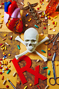 Medicines Photos - Skull and bones with medical icons by Garry Gay