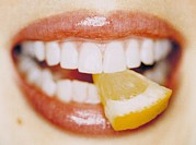 Biting Posters - Slice Of Lemon Between Teeth Poster by Cristina Pedrazzini
