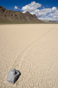 Dry Lake Photos - sliding rock on the Racetrack Playa Death Valley by Ed Book