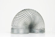 Familiar Object Posters - Slinky Toy Poster by Photo Researchers, Inc.