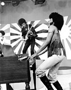 Sideburns Photo Framed Prints - Sly And The Family Stone Performing Framed Print by Everett