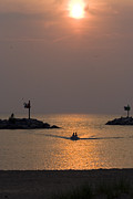 Boaters Prints - Small boat coming into harbor at New Buffalo Michigan close to sunset Print by Purcell Pictures