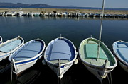 Boats In Harbor Posters - Small fishing boats lined up in a near row Poster by Sami Sarkis
