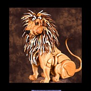 Animal Sculpture Framed Prints - Small Lion Framed Print by Thomas Thomas