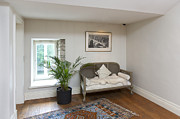 Couch Photos - Small Sofa in a Sparse Room by Jaak Nilson