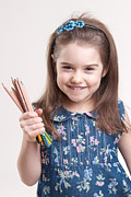 Little Sister Photos - Smiling happy little girl with pencils in her hand by Tania Gaidai