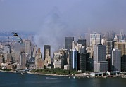 2000s Photo Posters - Smoke From The Ruins Of The World Trade Poster by Everett