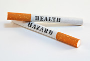 Smoking Cigarette Posters - Smoking is a health hazard Poster by Blink Images