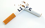 Smoking Cigarette Prints - Smoking shortens life Print by Blink Images