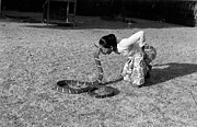 Mid Adult Women Prints - Snake Charmer Print by Bert Hardy